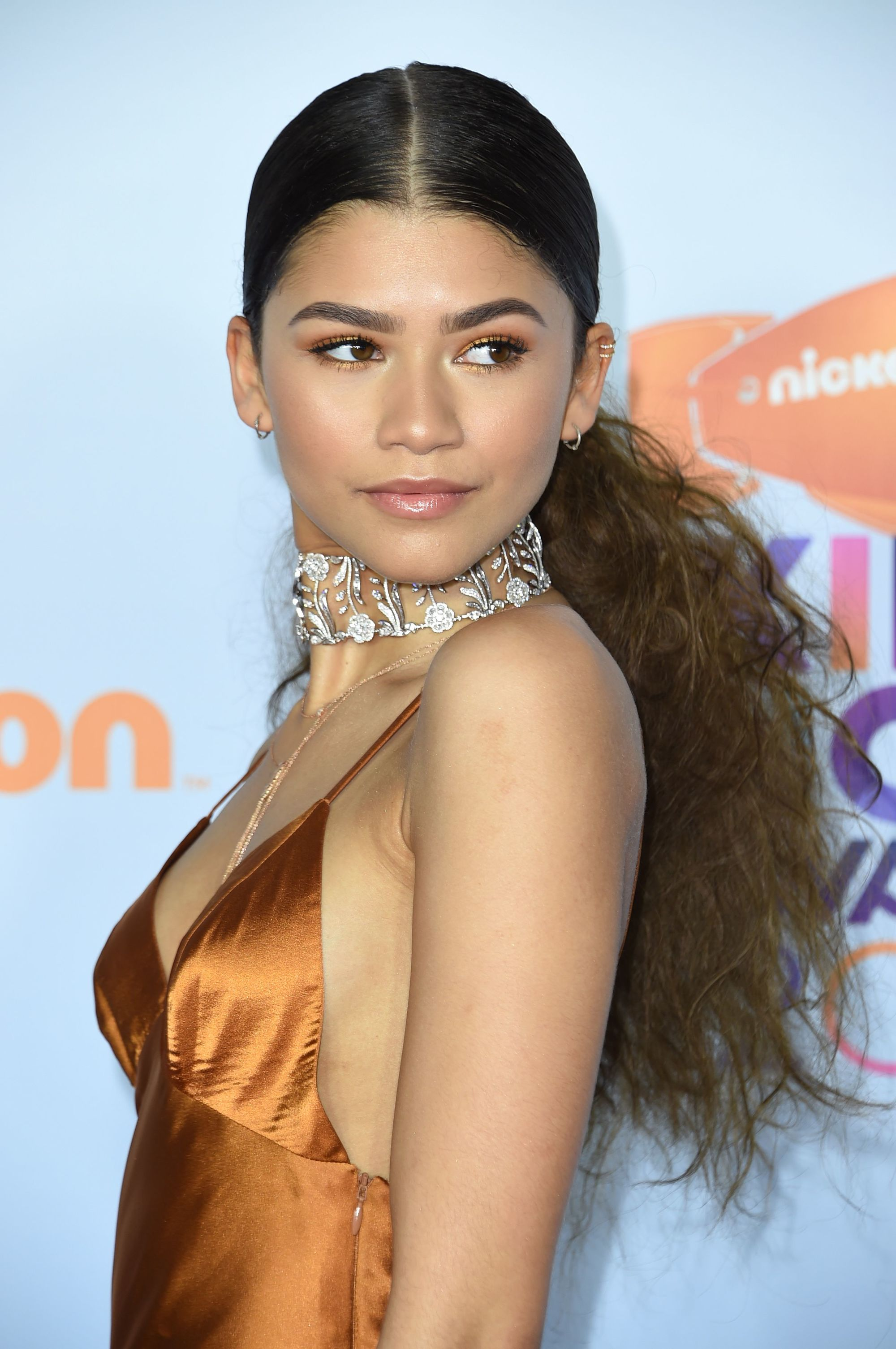 Actress Zendaya With Her Hair In A Sleek And Messy Low Ponytail