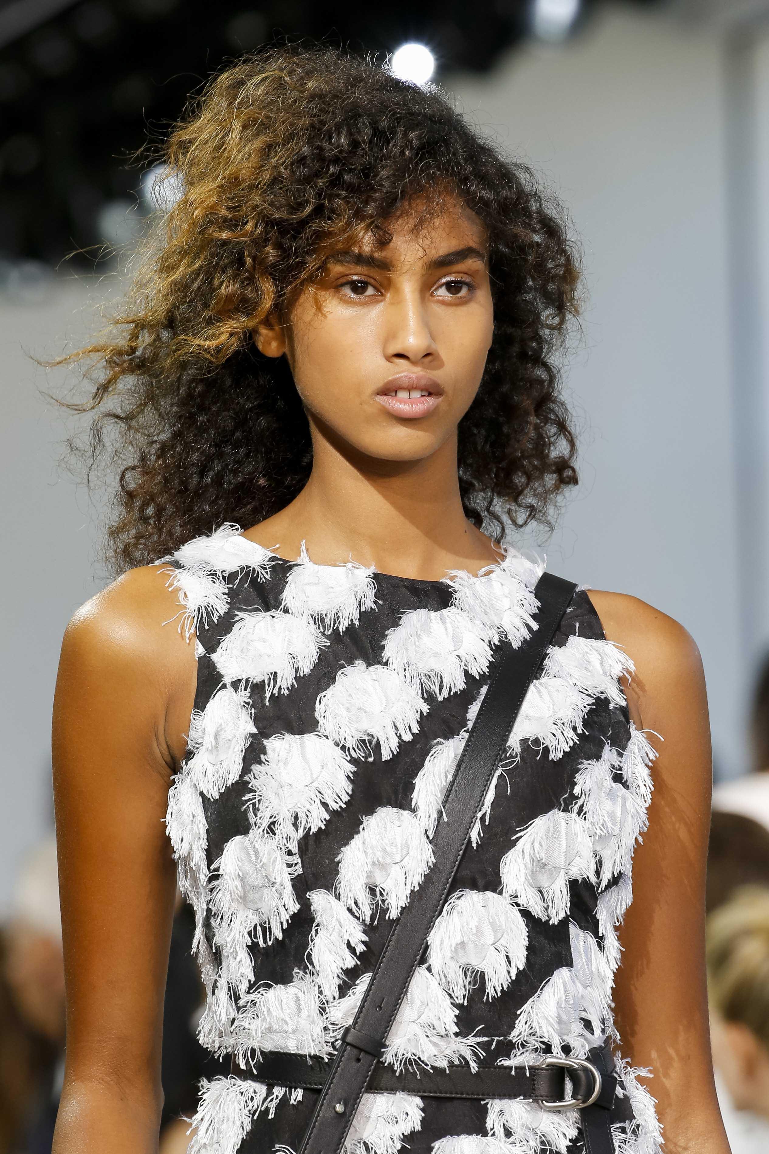 long layers haircut: bouncing layered haircuts with curly natural hair