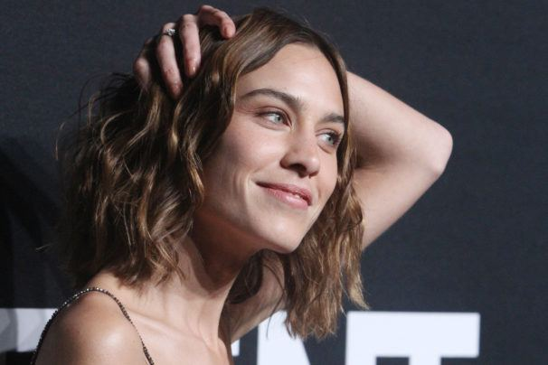 alexa chung with her hands in her lob length wavy brown hair