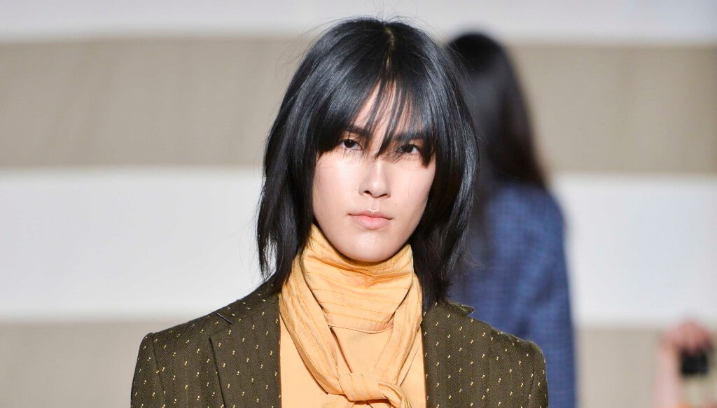 woman on catwalk with smooth long choppy bob with layered fringe