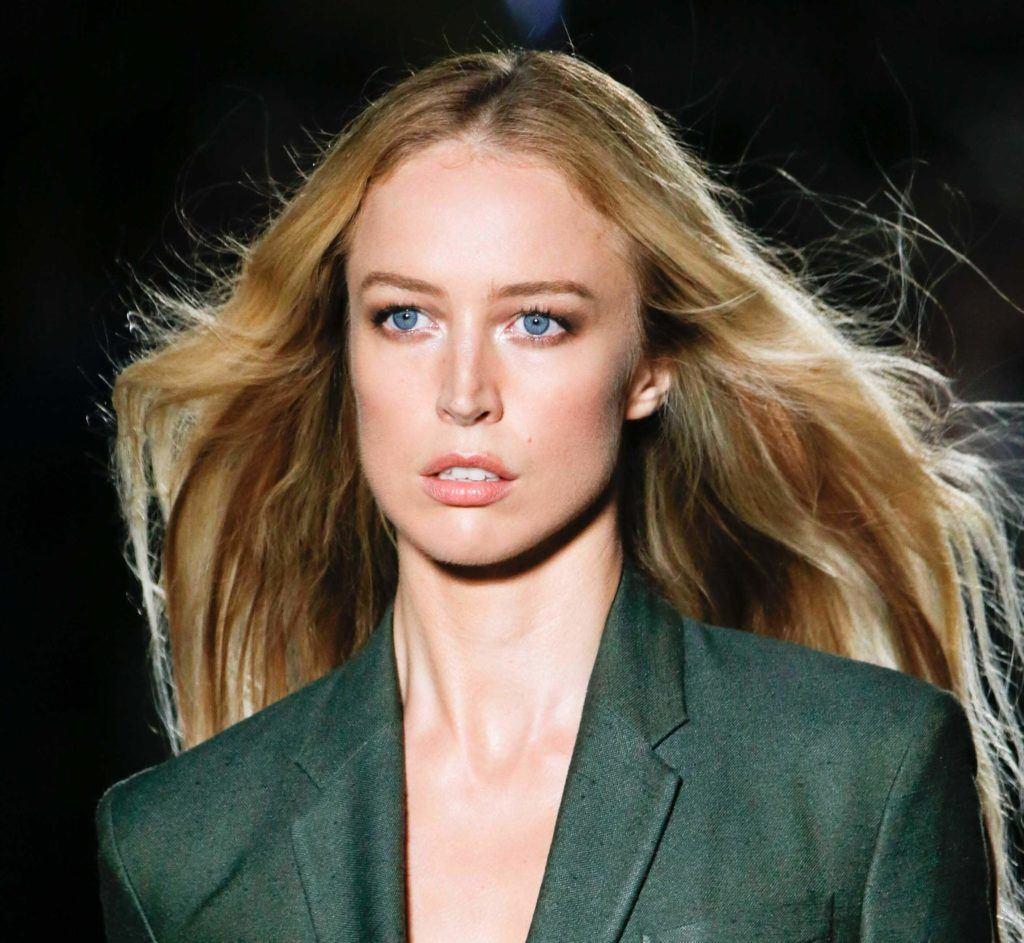 front view of a woman with long dark blonde hair worn down