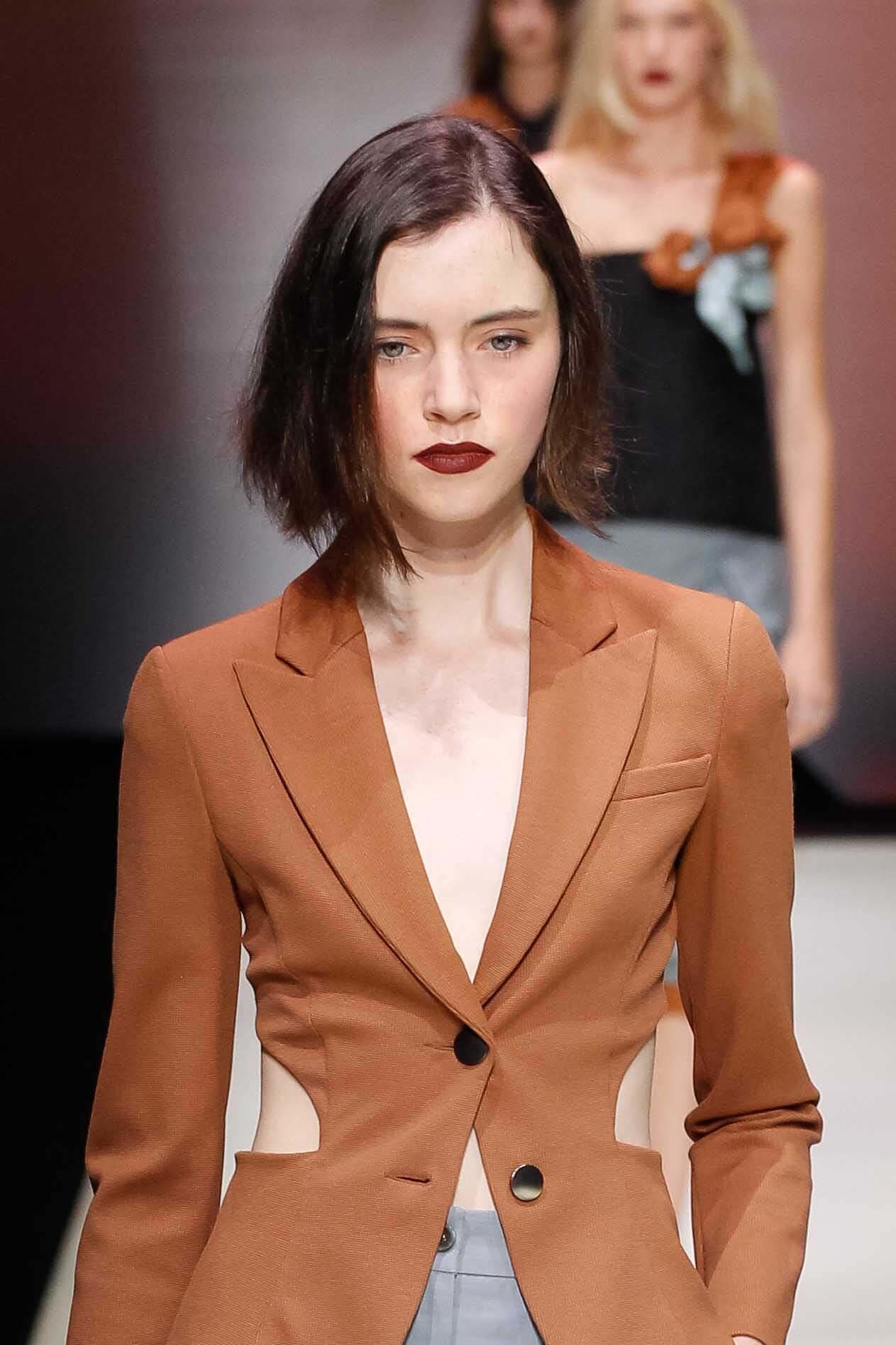 Will short hair suit me? Brunette with short bob wearing lipstick