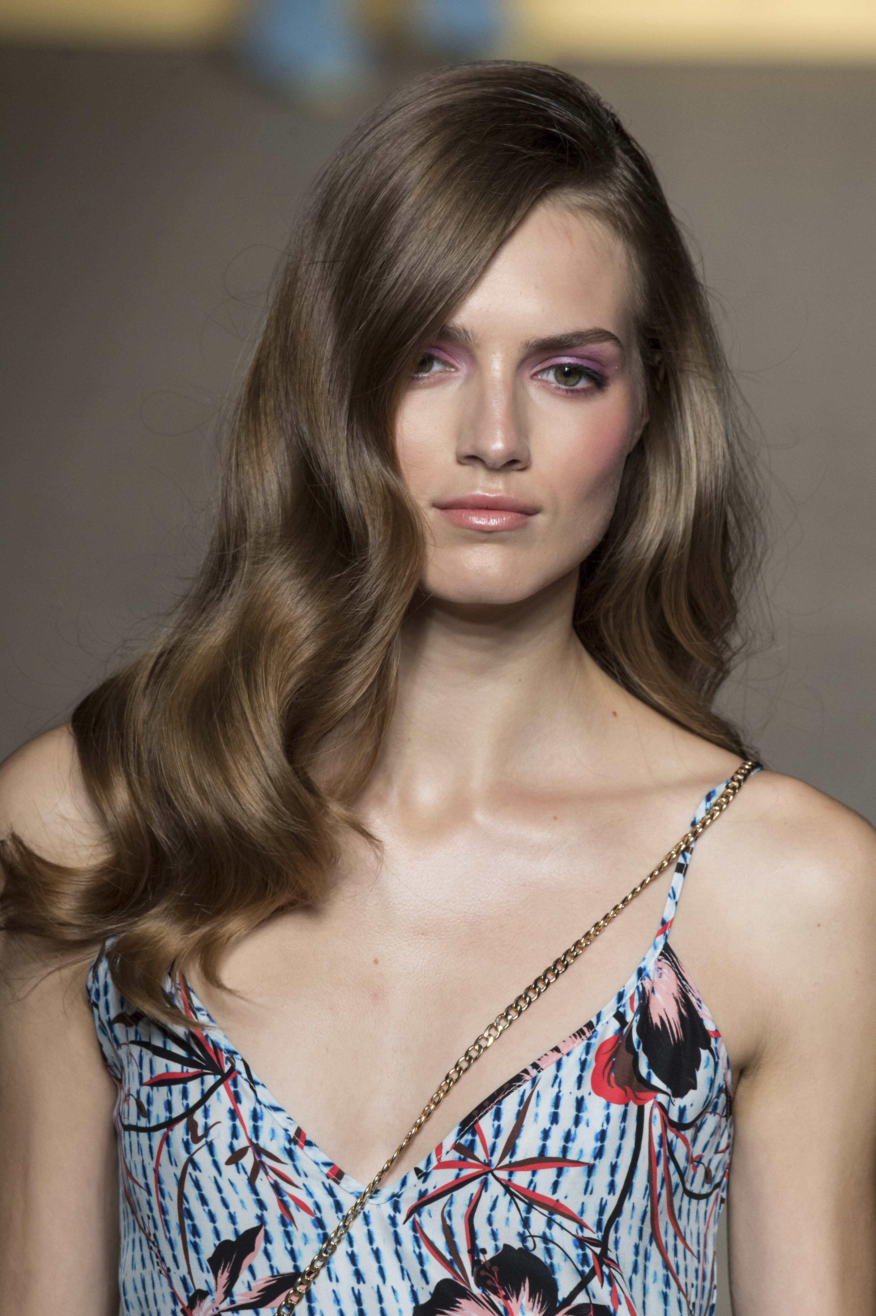 Medium brown haired model at Matthew Williamson SS15 with a glam wavy prom hairstyle