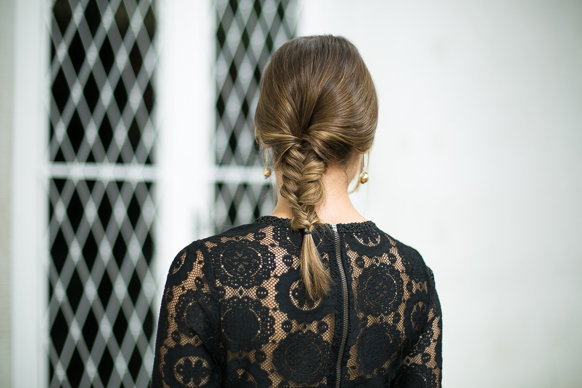 Updos with braids: Close up shot of a woman with a fishtail braid