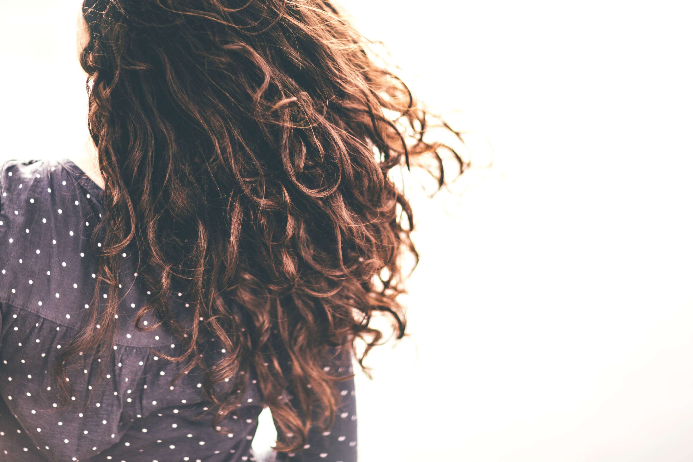 Brown haired woman with brown curly locks