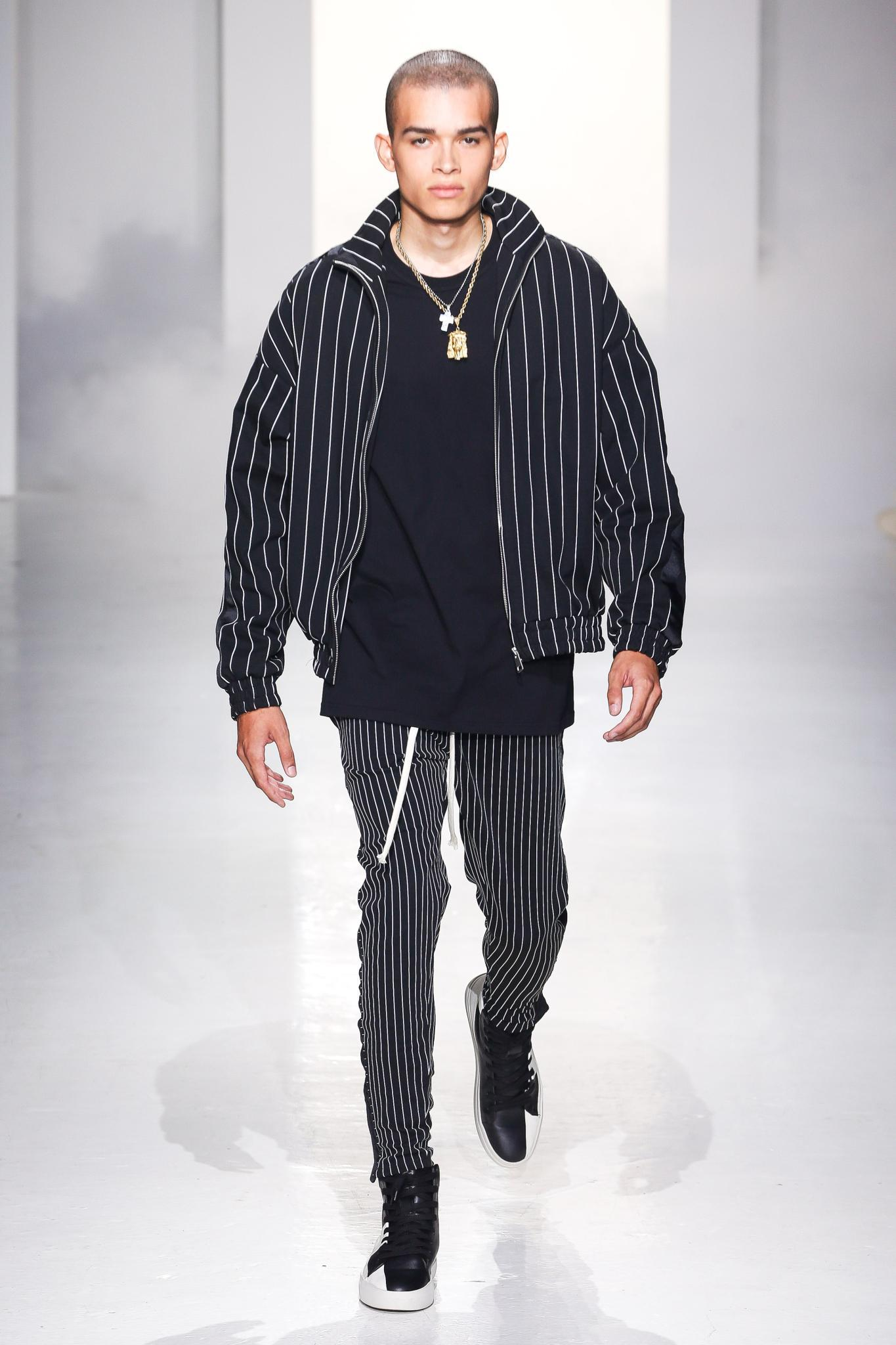 male model on catwalk with short buzzcut hair