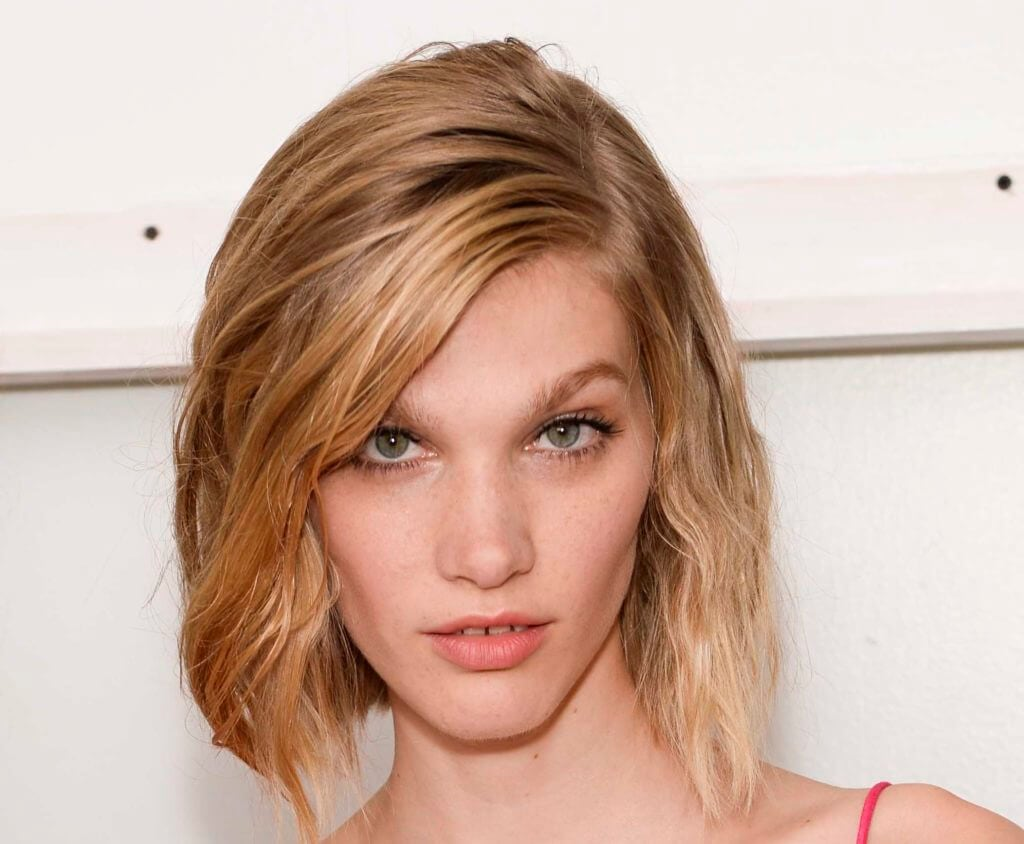 model with side parted short choppy bob hairstyle