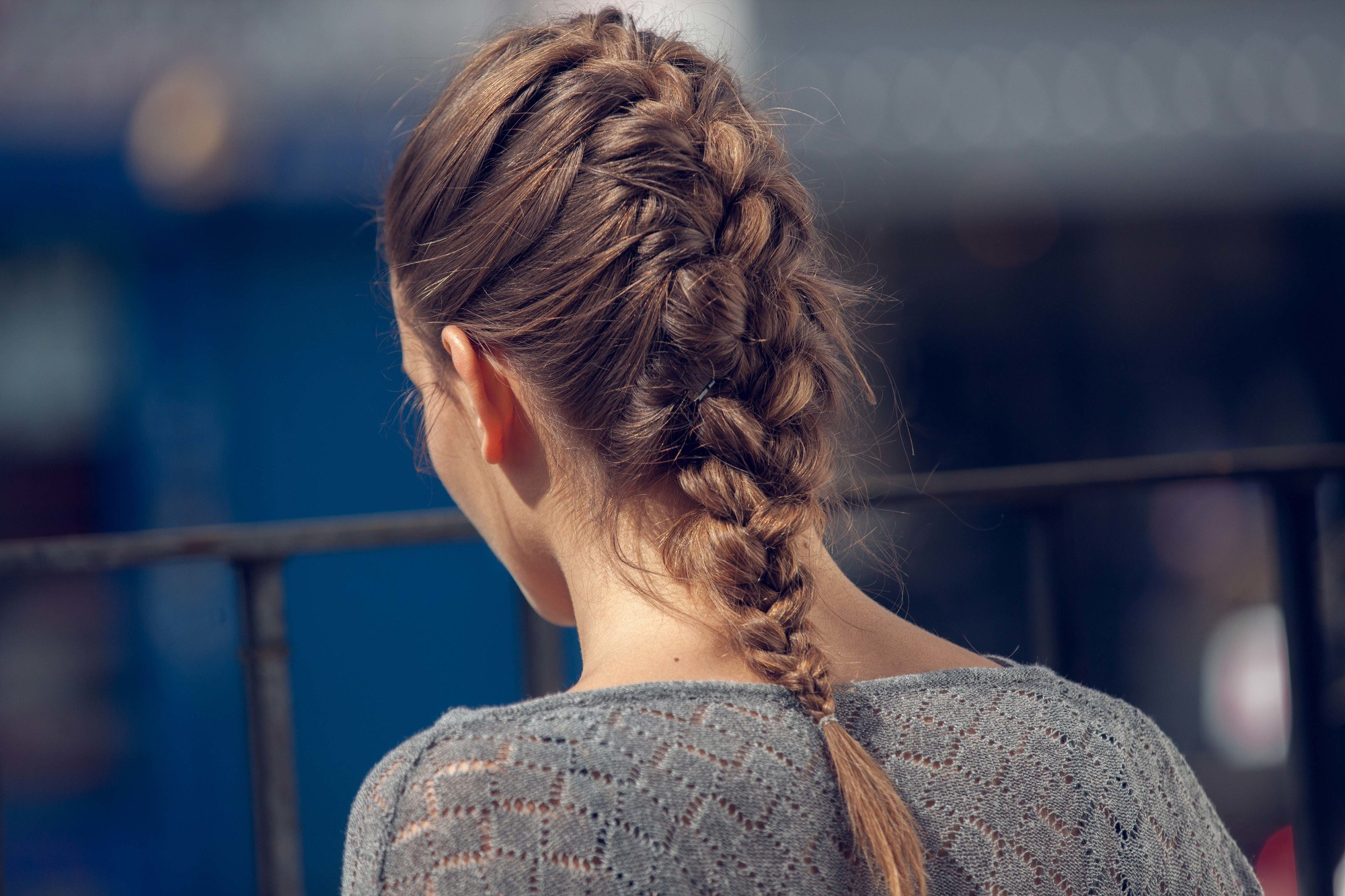 French braid hairtstyles: back view brunette with medium-length hair and a classic French plait