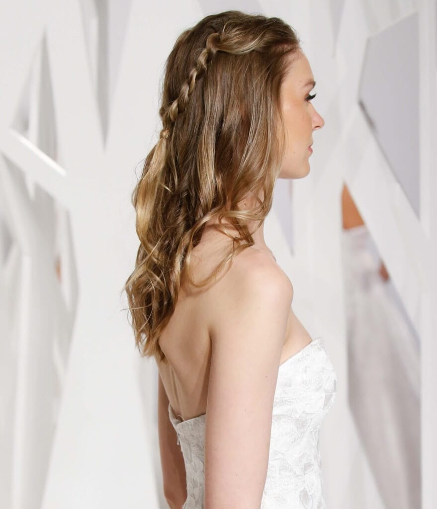 easy wedding style for curly hair: A blonde curly half-up twisted hairstyle