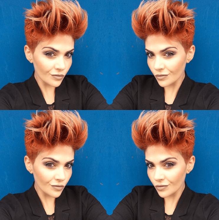 woman with dyed red hair cut into a pixie styled up in soft spikes