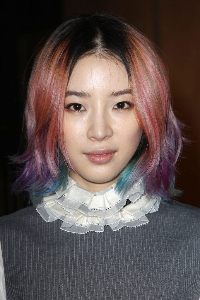 irene kim with pink purple hair in a bob style