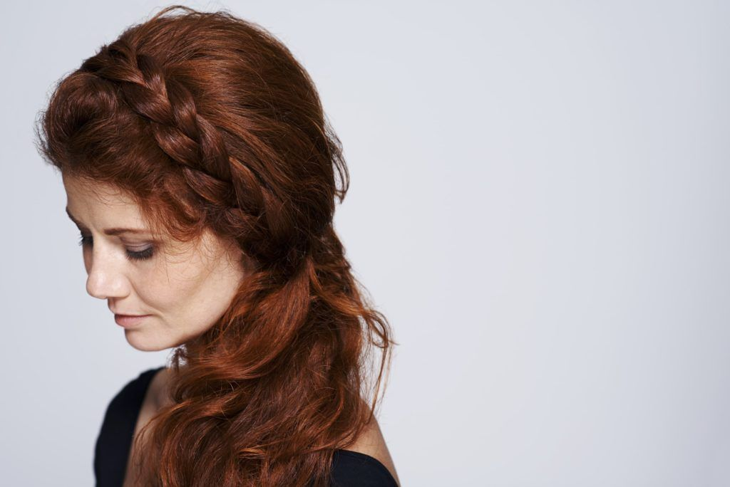 red head model with braided headband/headline prom hairstyles for curly hair