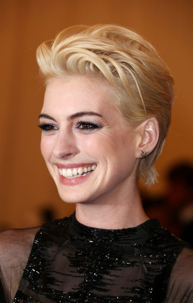 image of Anne Hathaway with bleached hair in a pixie cut and glamorous makeup