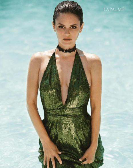 Night out hairstyles: Rachel Bilson wearing a green dress with dark slicked back hair