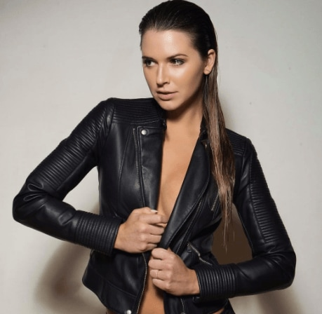 Night out hairstyles: Model wearing a leather jacket with dark long slicked back hair