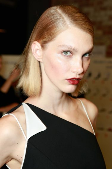 Should I cut my hair short? Blonde model with short bob haircut and red lipstick