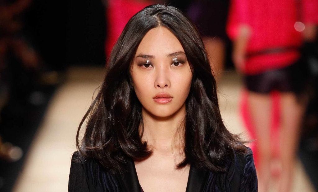 Haircuts for thick hair: Asian model on the runway with shoulder length dark layered hair