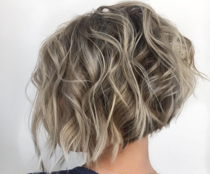 backshot of woman with stacked choppy bob cut on ash blonde hair