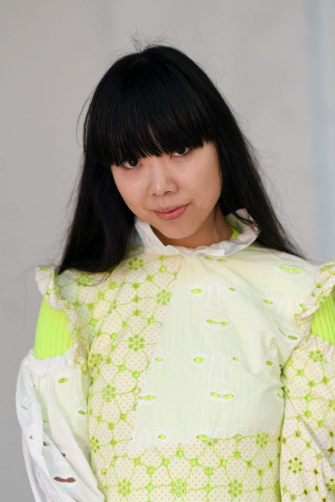 Haircuts for thick hair: Fashion blogger Susie Bubble with long dark hair with a full fringe