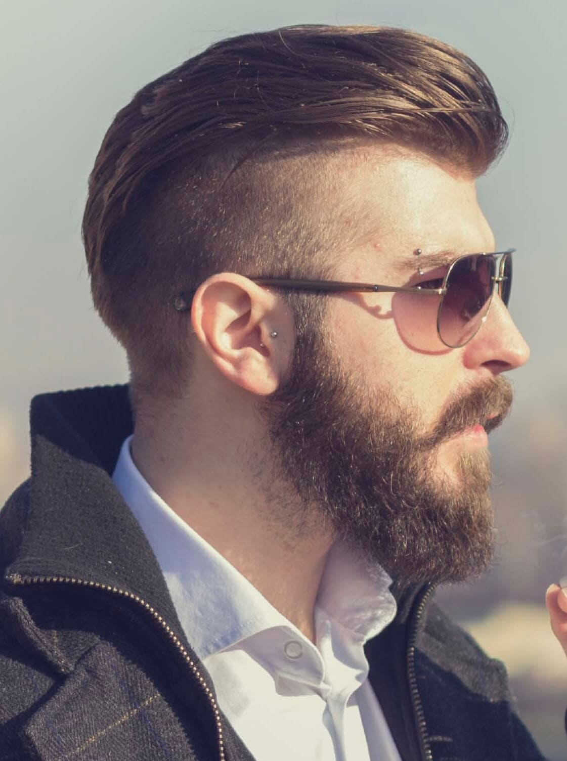The swoop haircut on bearded man