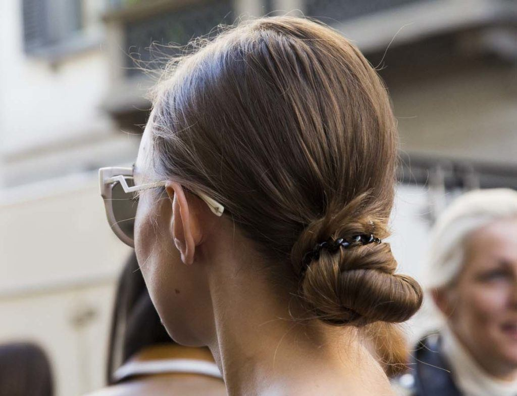 quick hairstyles for long hair: Brunette with a knotted bun
