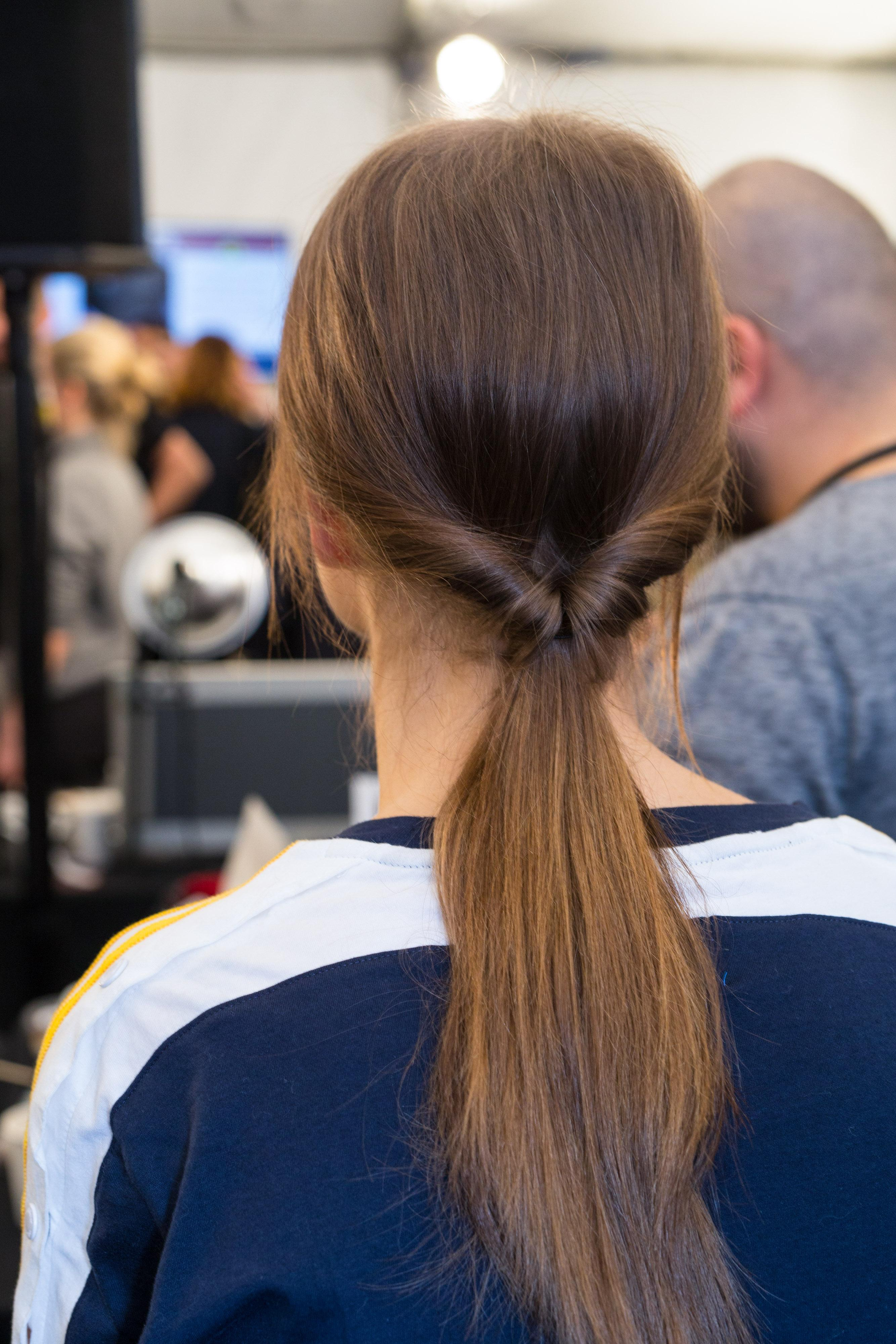 Easy hairdos for long hair: The back view of a brunette with a twisted ponytail