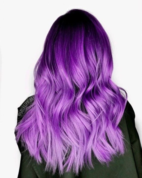 Hair trends: Woman with purple wavy long hair