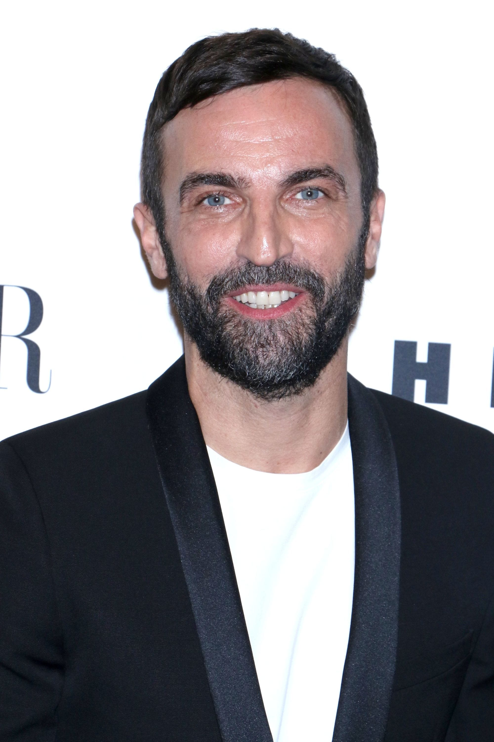 Hairstyles for men with thin hair: Nicolas Ghesquiere with short dark hair and a comb over hairstyle.