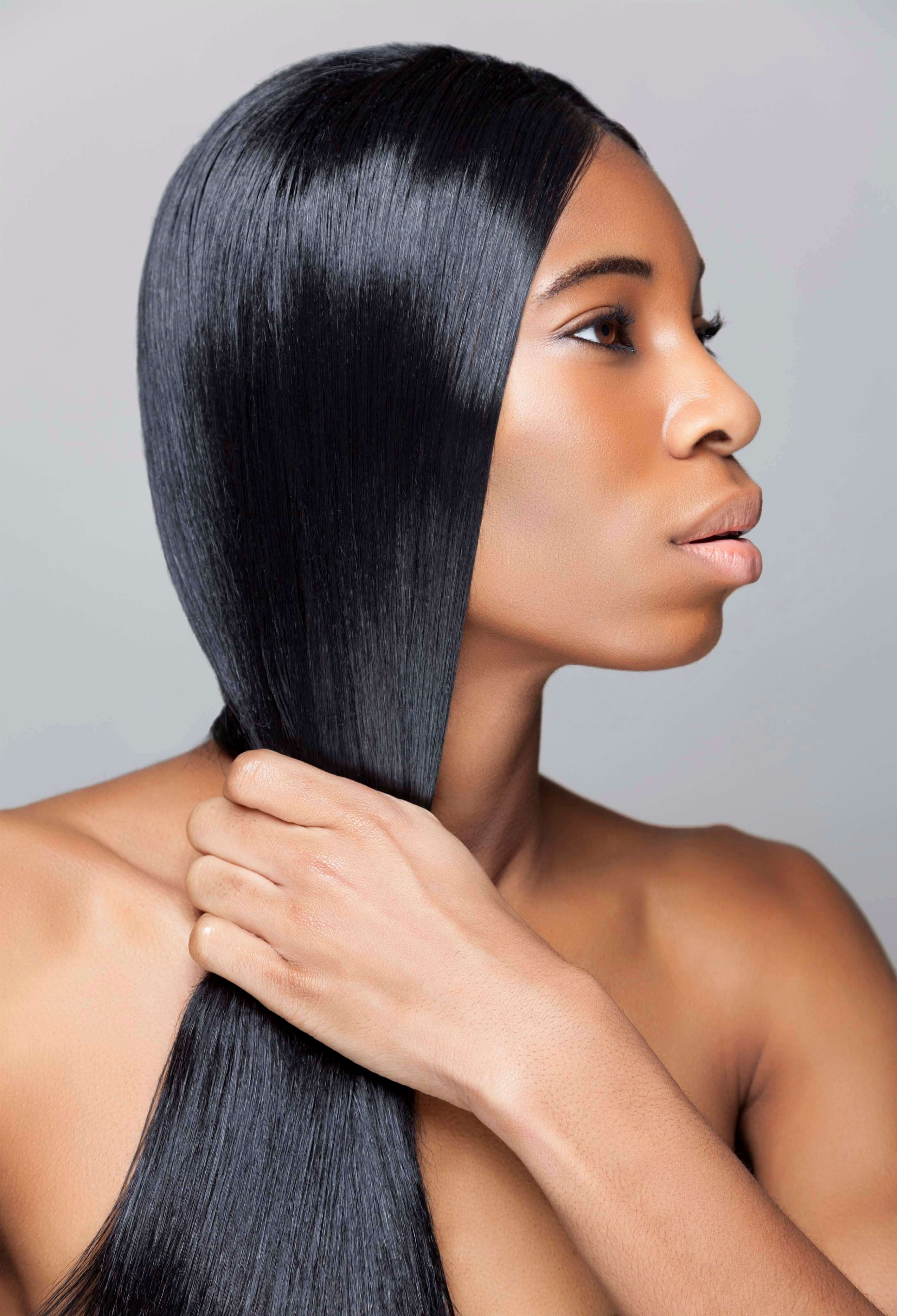 Relaxed hair: young black woman with long straight hair