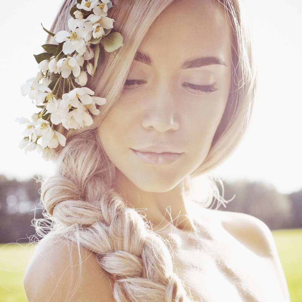 blonde woman with flowers in her hair