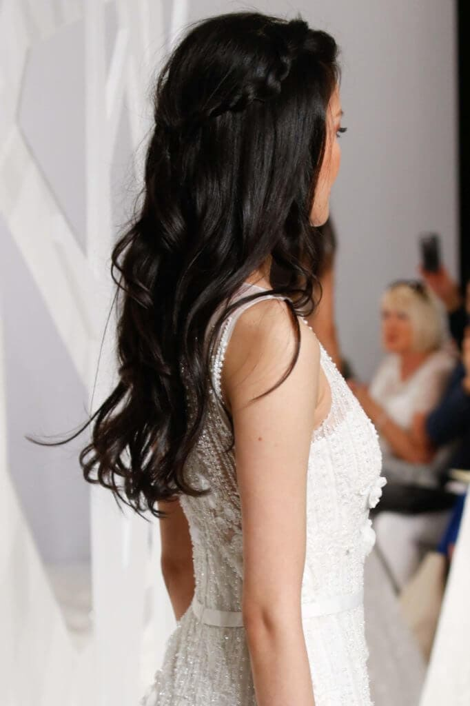 long hair with layers pinned back on dark brown hair