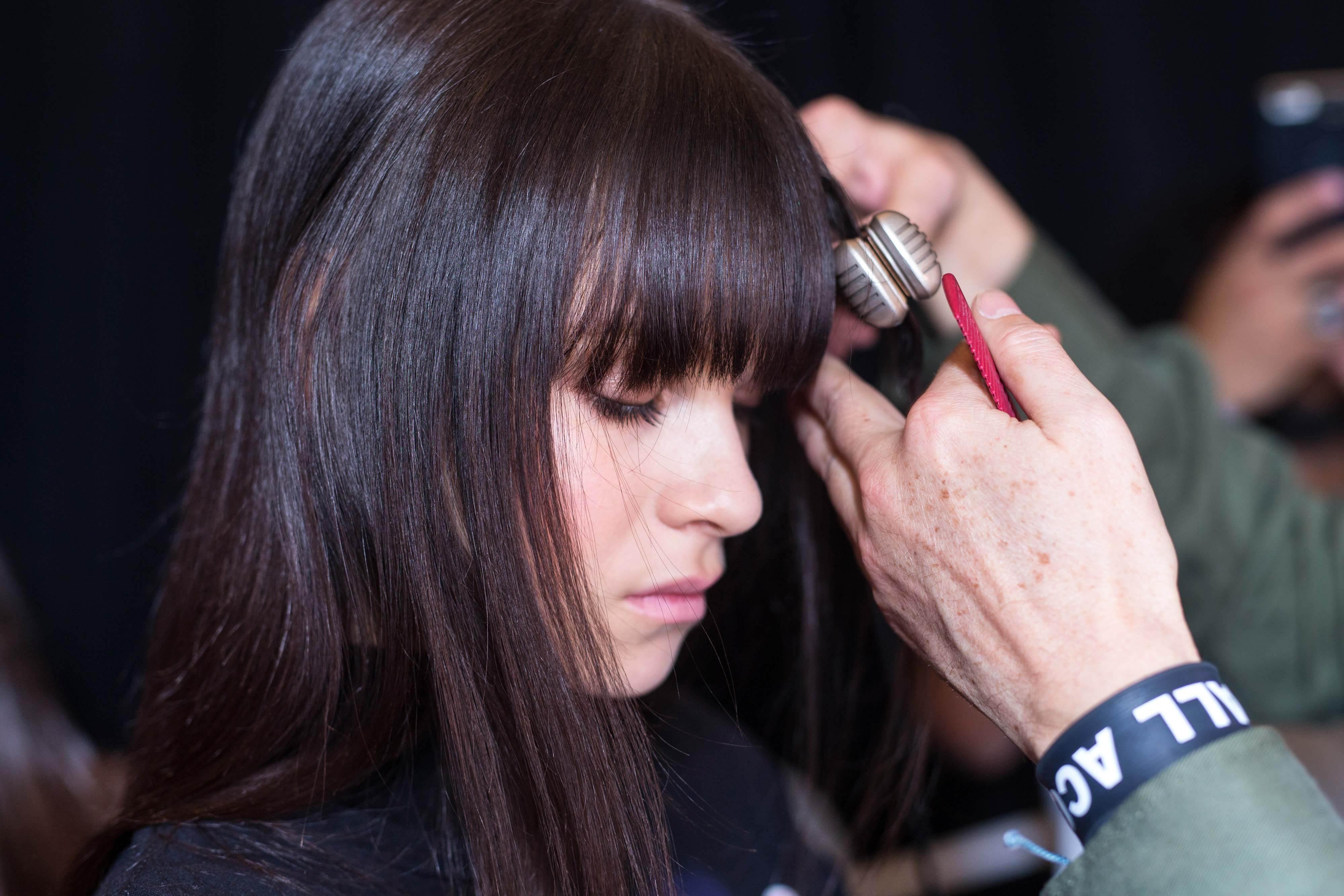 dark brown haired woman getting er straightened