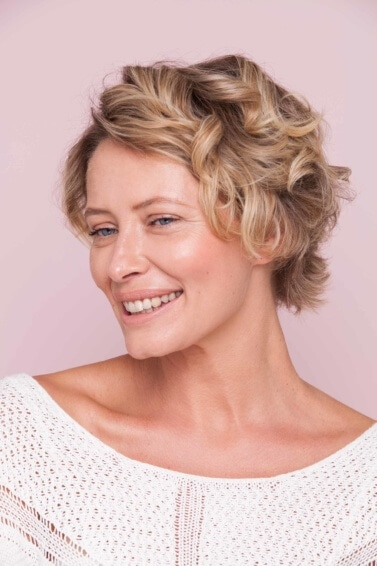 Older blonde woman with beach waves and short hair