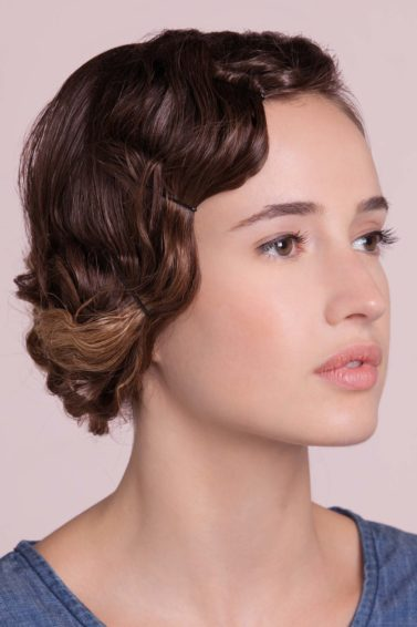 Brown haired girl with vintage waves 1920s inspired