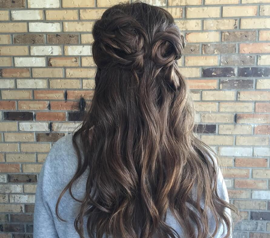 Game of Thrones hairstyles: Back view of a woman with long dark Cersei Lannister hair in flower braided buns
