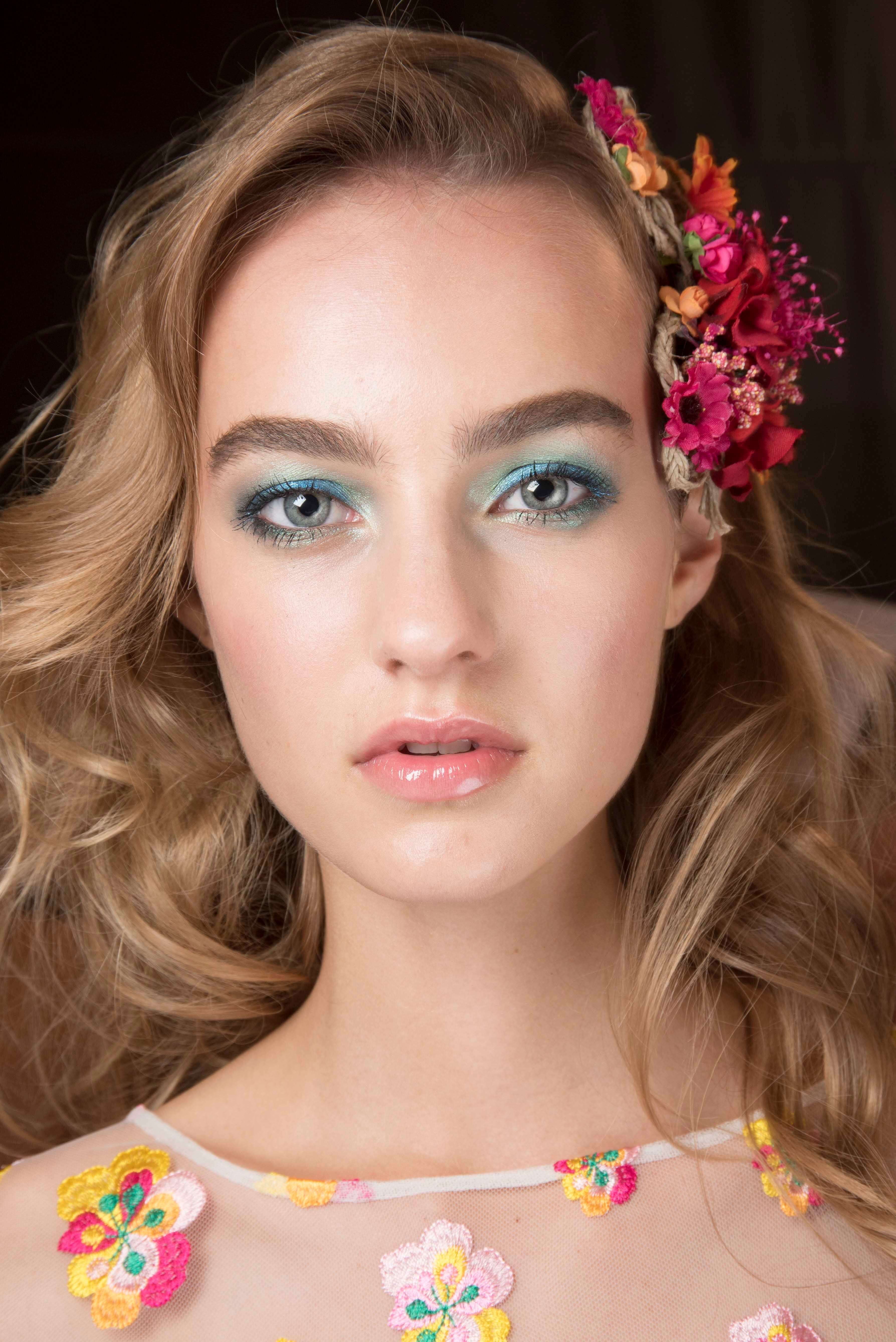 voluminous curls hairstyle accessorised with floral prom hairstyles for curl hair DVF SS16
