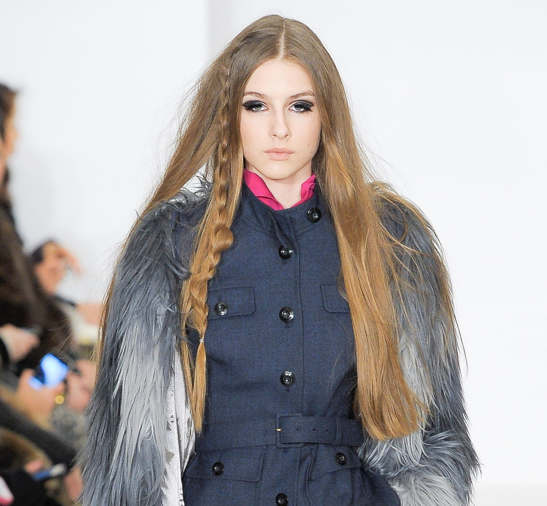 easy vintage hairstyles: close up shot of model on the rachel zoe runway, with long hair and a baby braid, wearing furry jacket and denim dress