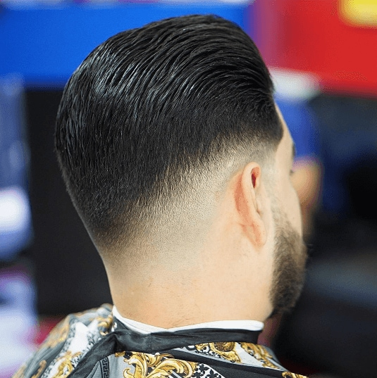 Dark haired man with low fade haircut