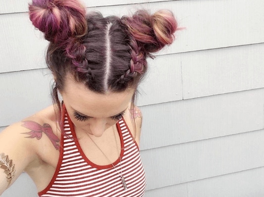 Summer hairstyles for long hair: A young Instagramer with braided, pink space buns