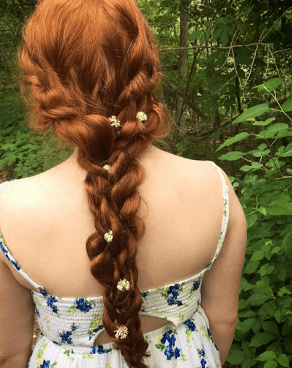 red hair with braided twists and flowers