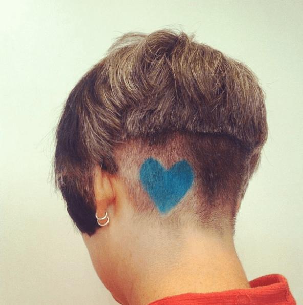 Short haircut with undercut and graffiti sprayed blue heart
