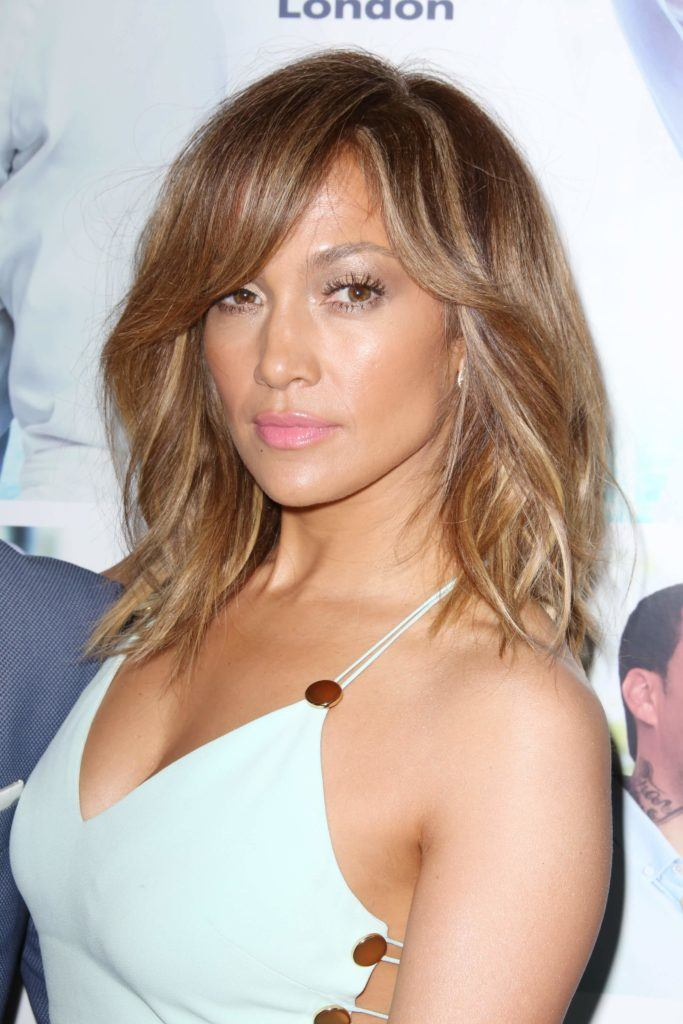 Jennifer Lopez with light brown balayage hair in a long bob hairstyle