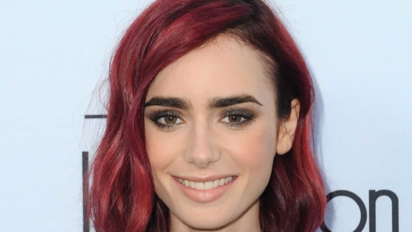 red hair lily collins wows on the red carpet with bright red hair