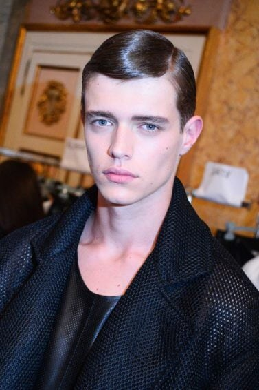 man with slick wet look side parting