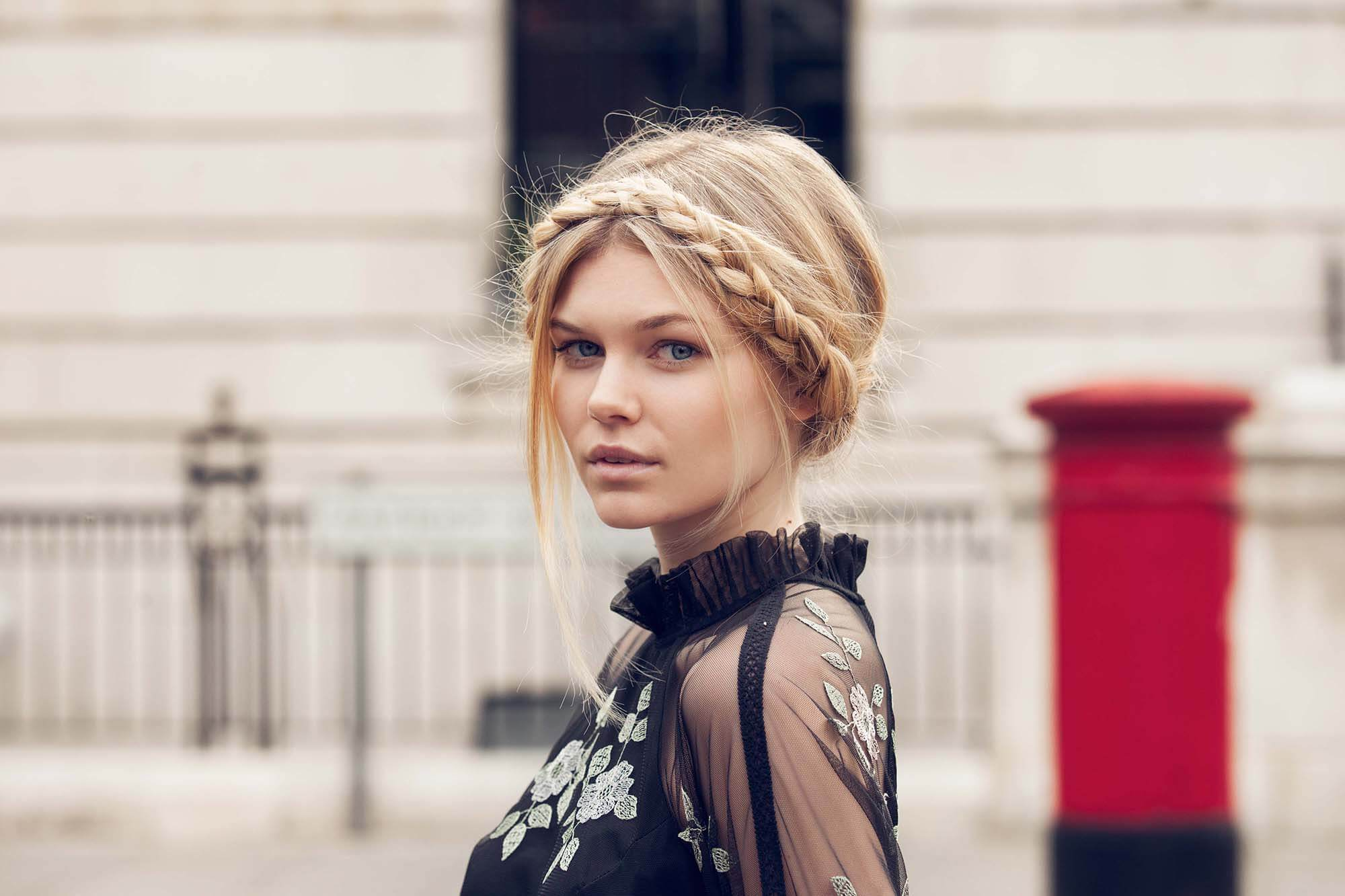 blonde model with milkmaid braid and a black lace top