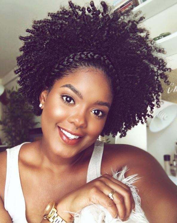 Game of Thrones hairstyles: Woman with a headband braid on black curly afro hair