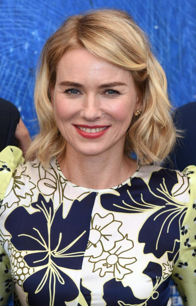 Naomi Watts with blonde hair in a side parting with waves