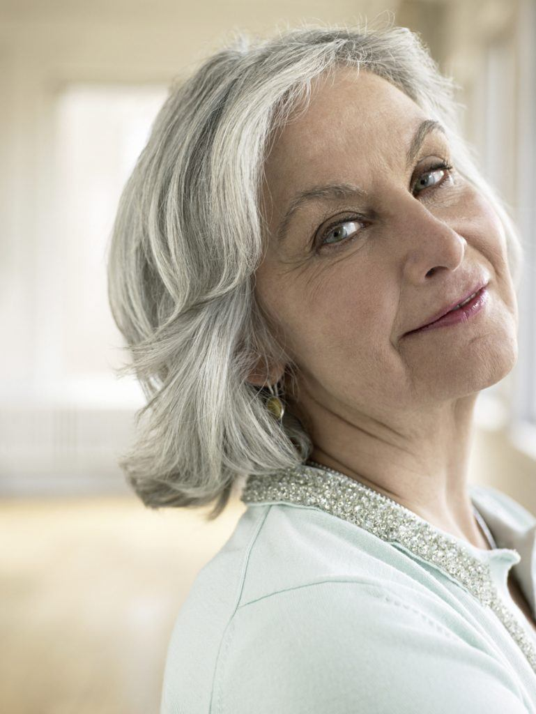 Feathered hairstyles: All Things Hair - IMAGE - older woman with grey feathered hair