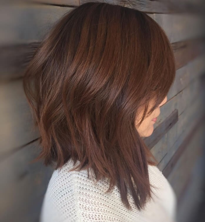 woman with long graduated bob hairstyle on medium toned brown hair