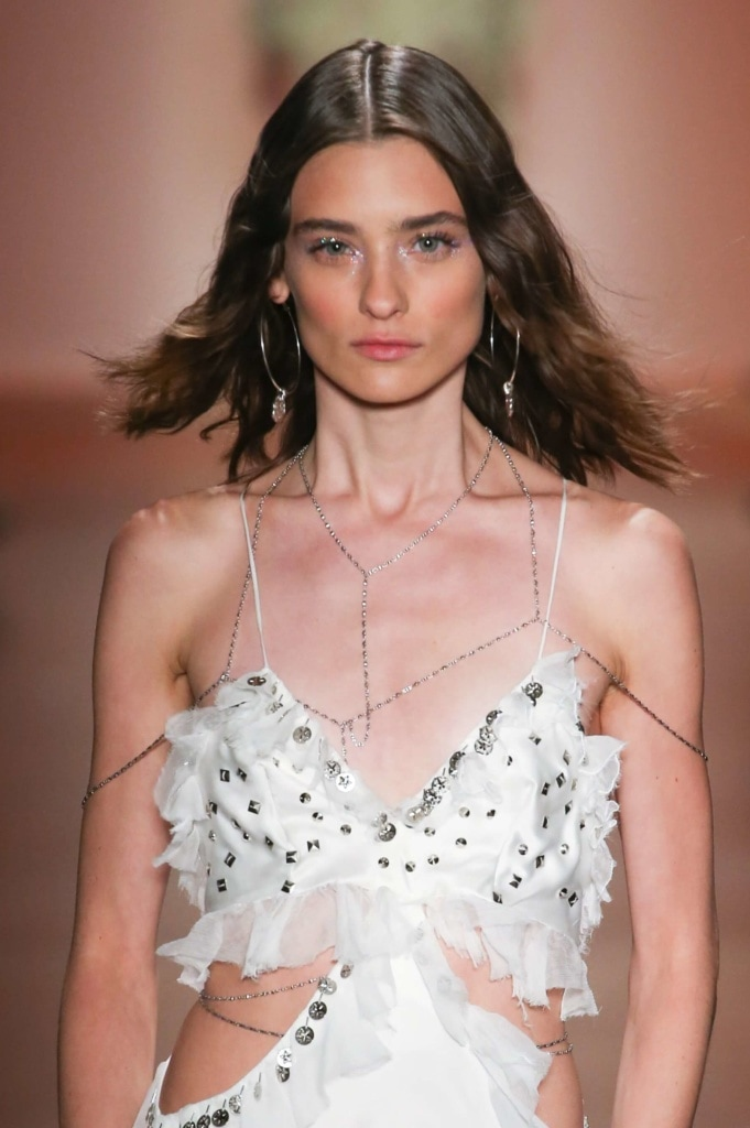 model on the runway with shoulder length hair and beachy waves